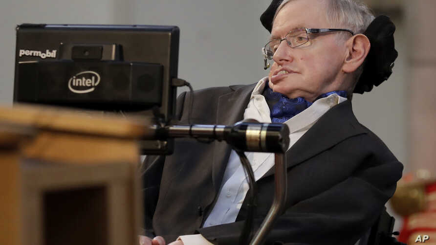 "FILE - In this March 6, 2017, photo, Stephen Hawking receives the Honorary Freedom of the City of London. Cambridge University has put Hawking's doctoral thesis online, Oct. 23, 2017. ""Properties of Expanding Universes"" explores ideas about the origi"