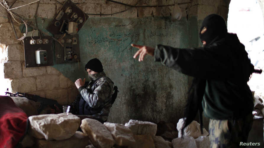 Jihadist fighters from the Jabhat al-Nusra group take up positions in Aleppo during a battle against Syrian government forces December 24m 2012. Al-Nusra fighters are also accused of clashes with other anti-govrnment rebels.