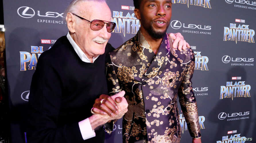 "Stan Lee, left, greets cast member Chadwick Boseman at the premiere of ""Black Panther"" in Los Angeles, Jan. 29, 2018."