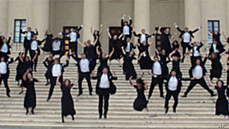 The Yale Glee Club, seen here leaping on the steps of the main concert hall in the Dominican Republic, is celebrating its 150th anniversary.