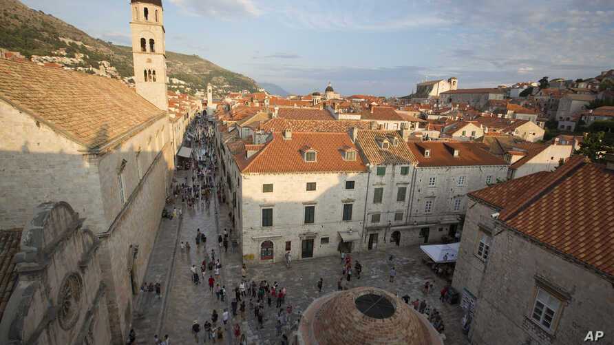 Crowds of tourists clog the entrances into the ancient walled city of Dubrovnik, a UNESCO World Heritage Site in Croatia, as huge cruise ships unload thousands more daily, Sept. 7, 2018