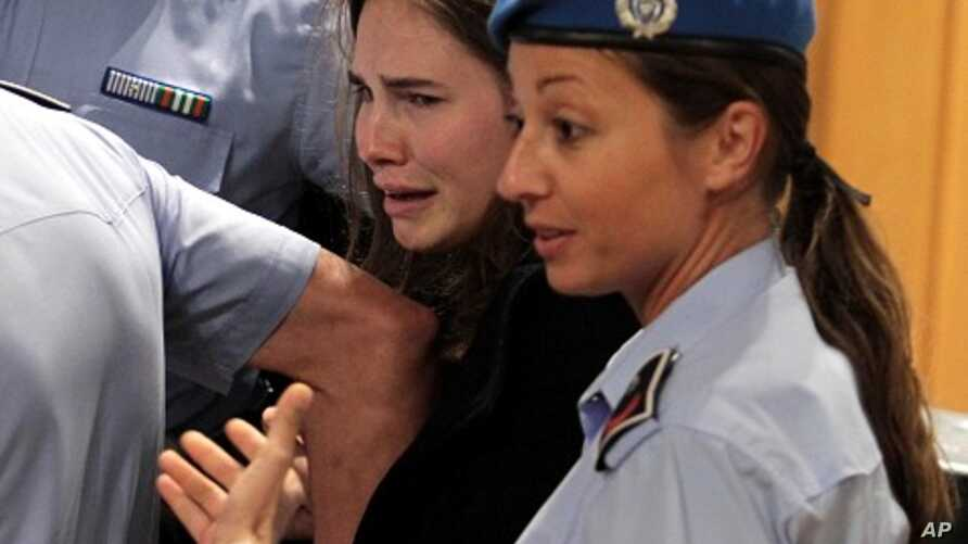 US Amanda Knox cries as she leaves the court after being acquitted in her appeal trial for Meredith Kercher's murder on October 3, 2011 at Perugia's court.
