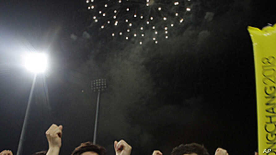 South Korean supporters in Pyeongchang, South Korea celebrate after the IOC announced that Pyeongchang had won the vote to be the host city for the 2018 Winter Olympics, July 7, 2011