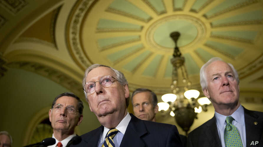 FILE - Senate Majority Leader Mitch McConnell of Ky., with from left, Sen. John Barrasso, R-Wyo., Sen. John Thune, R-S.D., and Senate Majority Whip John Cornyn of Texas, attend a news conference on Capitol Hill in Washington, June 21, 2016.