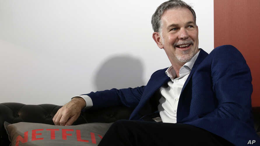 Founder and CEO of Netflix Reed Hastings smiles during an interview with The Associated Press in Barcelona, Spain, Feb. 28, 2017.