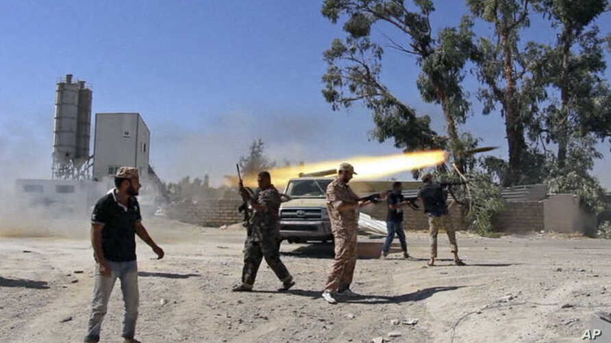 In this July 26, 2014 frame grab from video obtained from a freelance journalist traveling with the Misarata brigade, fighters from the Islamist Misarata brigade fire towards Tripoli airport in an attempt to wrest control from a powerful rival militi
