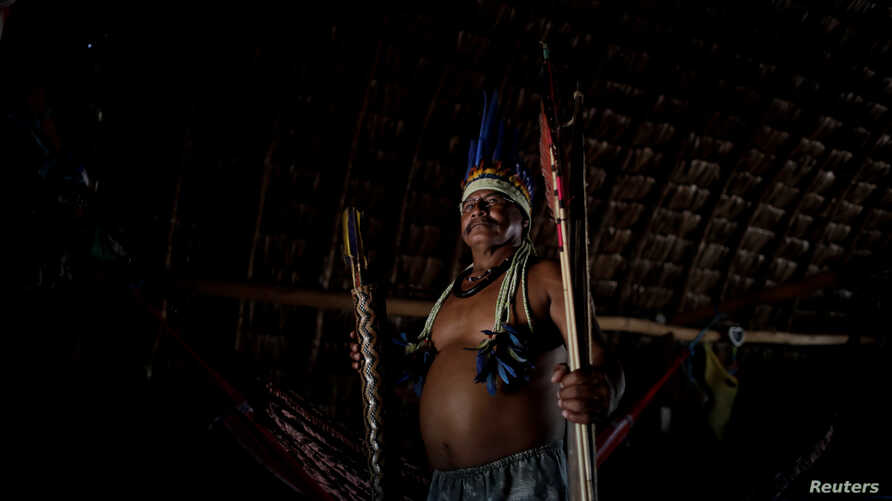 Chief Joao Ponce, head of the Uirapuru indigenous community, poses for a photograph inside his house near the town of Conquista do Oeste, Brazil, April 24, 2018.