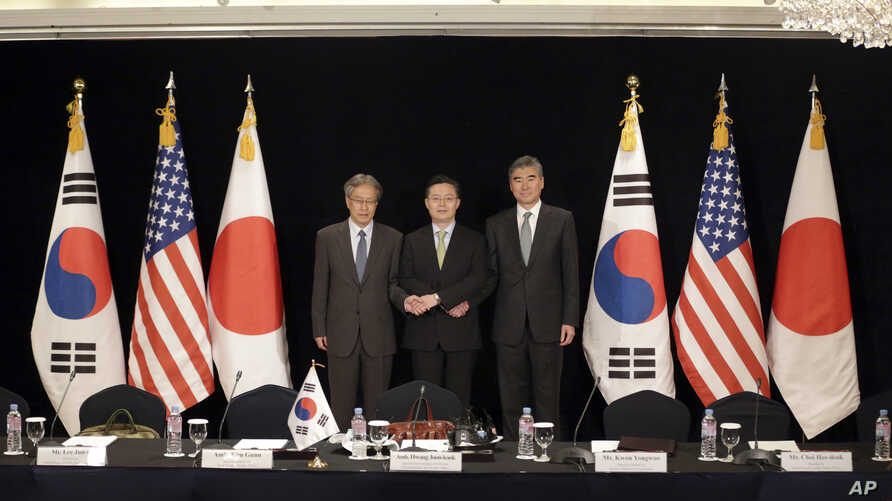 South Korea's Special Representative for Korean Peninsula Peace and Security Affairs Hwang Joon-kook, center, U.S. State Department's Special Representative for North Korea Policy Sung Kim, right, and Japanese Foreign Ministry's Director-General for