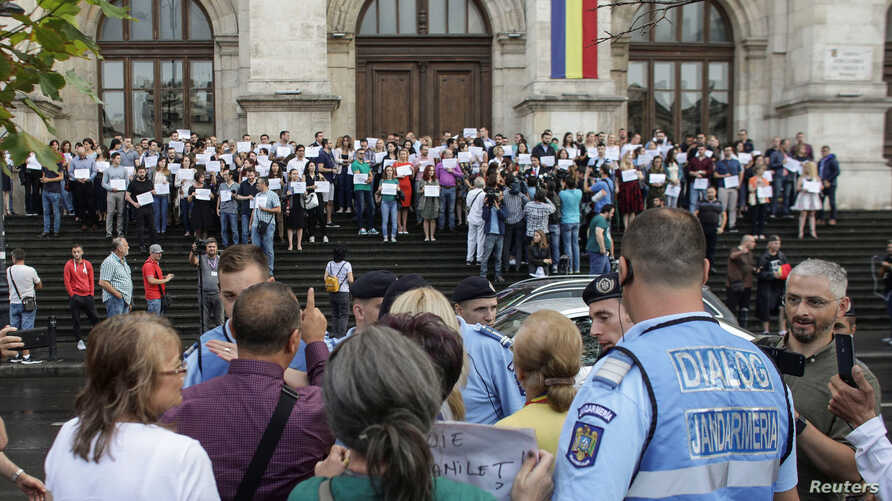 FILE - Romanian magistrates hold a silent protest in support of an independent judiciary in capital Bucharest in Bucharest, Romania, Sept.16, 2018.