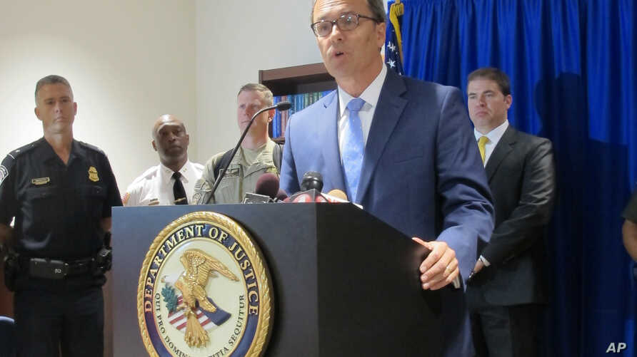 FILE - U.S. Attorney William Hochul speaks about the arrest of Arafat Nagi during a news conference in Buffalo, N.Y., July 29, 2015. Nagi has pleaded guilty of trying to help Islamic State.