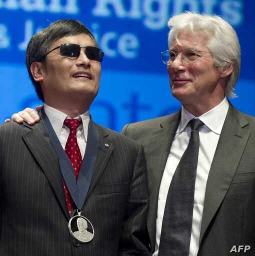 Chinese activist lawyer Chen Guangcheng (L) stands alongside actor Richard Gere (R) after being presented Tom Lantos Human Rights Prize Jan 29, 2013