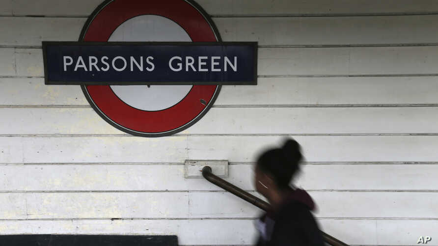 A passenger walks onto the platform at Parsons Green subway station after it was reopened, Sept. 16, 2017, following a terrorist attack on a train at the station in London.