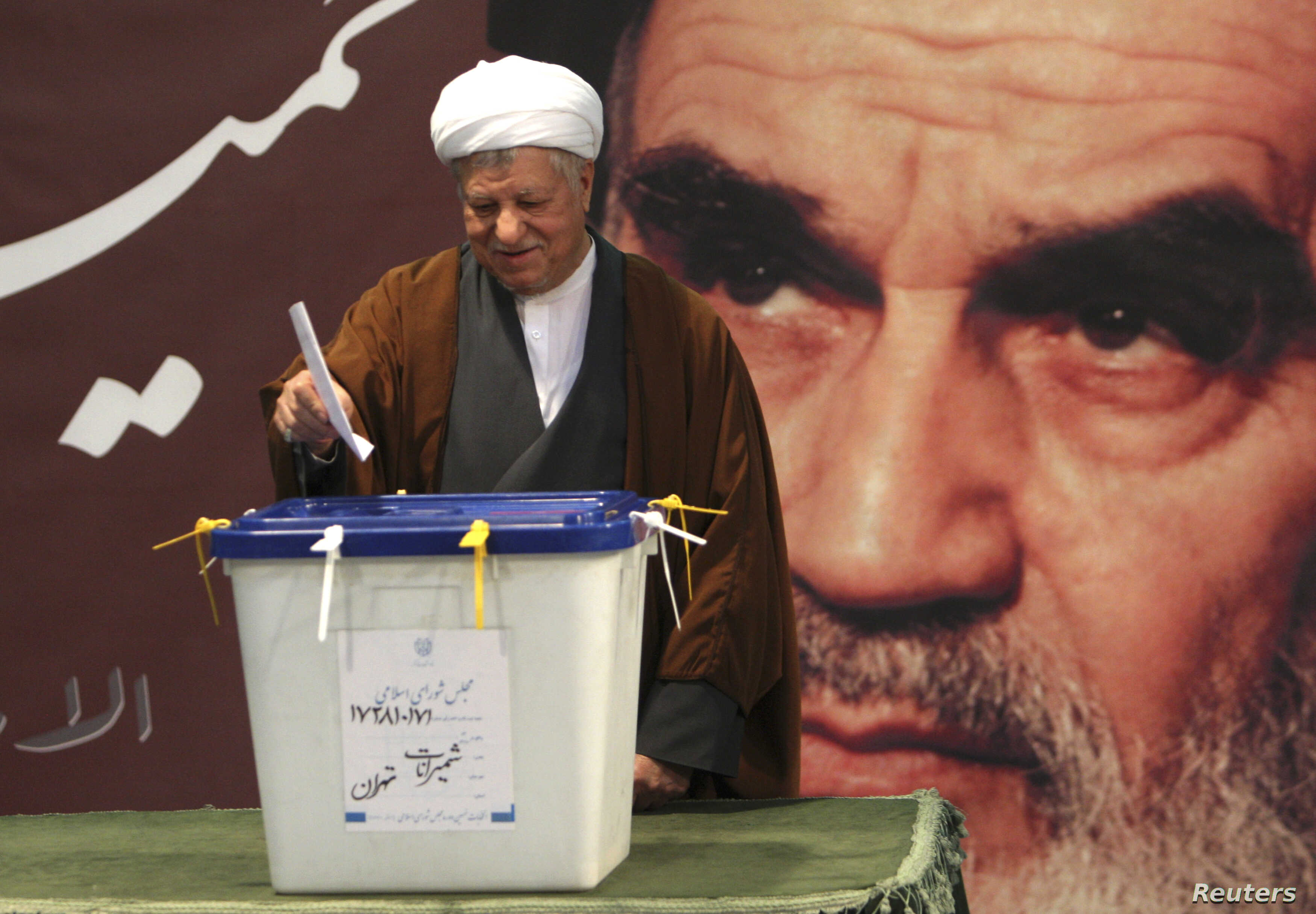 Former Iranian President Ali Akbar Hashemi Rafsanjani is seen casting his ballot in parliamentary elections in Tehran in this March 2, 2012, file photo.