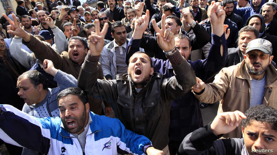 Mourners chant slogans against Libyan leader Muammar Gaddafi during a funeral for a Libyan who was killed by security forces according to his family, in the Tajoora neighborhood in Tripoli, Feb. 26, 2011.