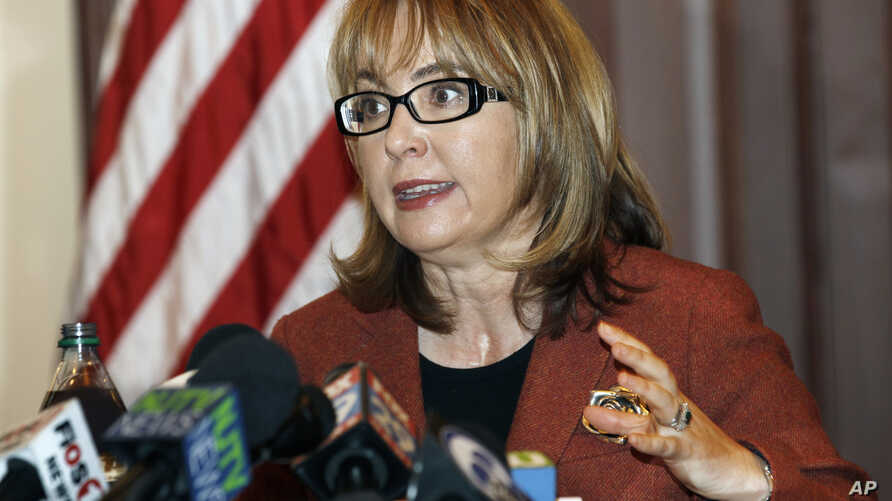 FILE - Former U.S. Rep. Gabrielle Giffords of Arizona, who co-founded the gun control group Americans for Responsible Solutions with her husband, delivers a speech in Trenton, N.J., March 18, 2015.