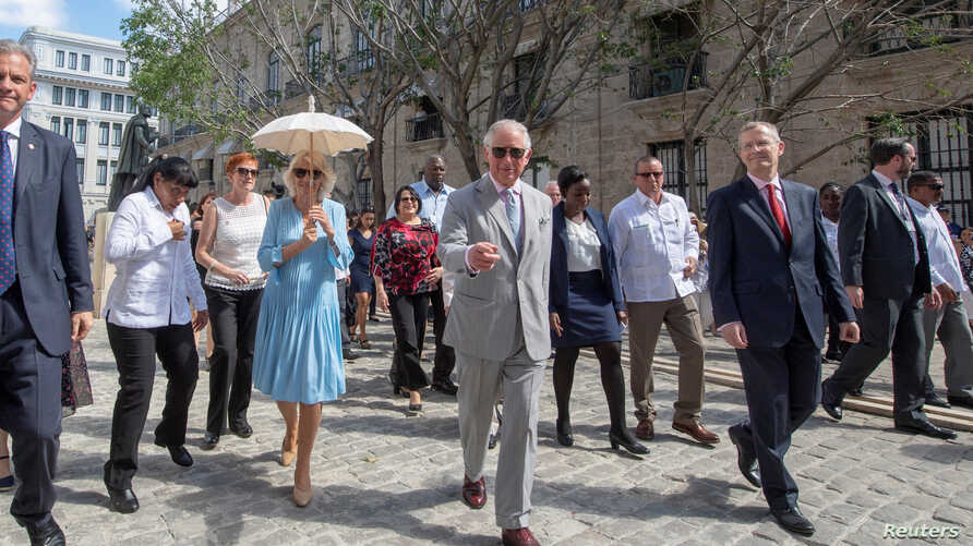 Britain's Prince Charles and Camilla, Duchess of Cornwall are seen during a guided tour of Old Havana in Havana, Cuba, March 25, 2019.