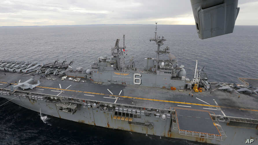 FILE - The USS Bonhomme Richard amphibious assault ship sails in the Pacific Ocean off the coast of Sydney after a ceremony on board the ship marking the start of Talisman Saber 2017, a biennial joint military exercise between the United States and A