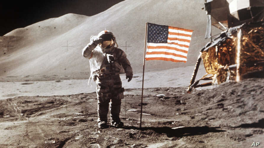 FILE - In this July 30, 1971 NASA photo, Apollo 15 Lunar Module Pilot James B. Irwin salutes while standing beside the fourth American flag planted on the moon. On March 26, 2019, Vice President Mike Pence called for landing astronauts on the moon wi