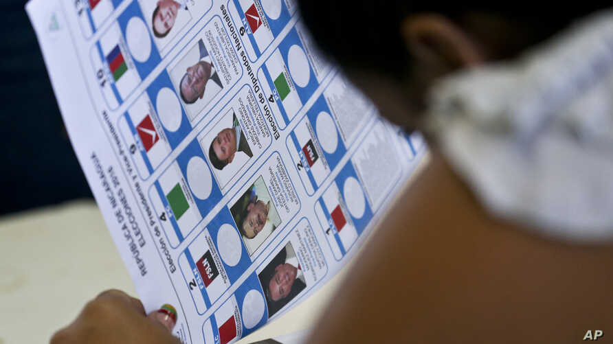 An electoral worker prepares a ballot at a polling station in an elementary school in Managua, Nicaragua, Nov. 6, 2016.