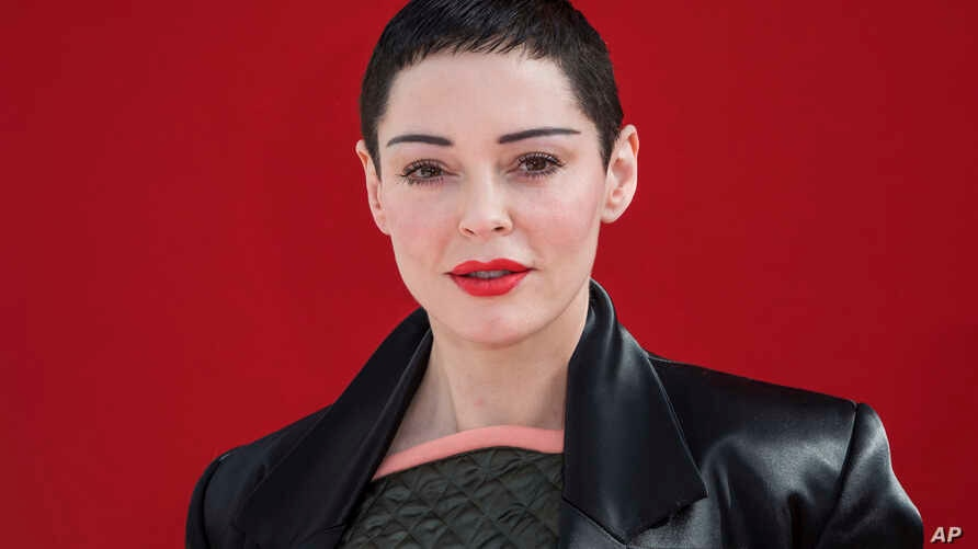 FILE - Actress Rose McGowan poses for photographers before the Andreas Kronthaler for Vivienne Westwood ready-to-wear fall/winter 2018/2019 fashion week runway show in Paris, March 3, 2018.