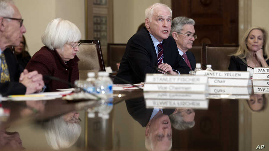 FILE - Federal Reserve Board member Daniel Tarullo, center, accompanied by Chair Janet Yellen (2nd Left) Vice Chair Stanley Fischer (L), Jerome Powell, (2nd R) and Lael Brainard (R) during an open board meeting in Washington, Dec. 15, 2016.