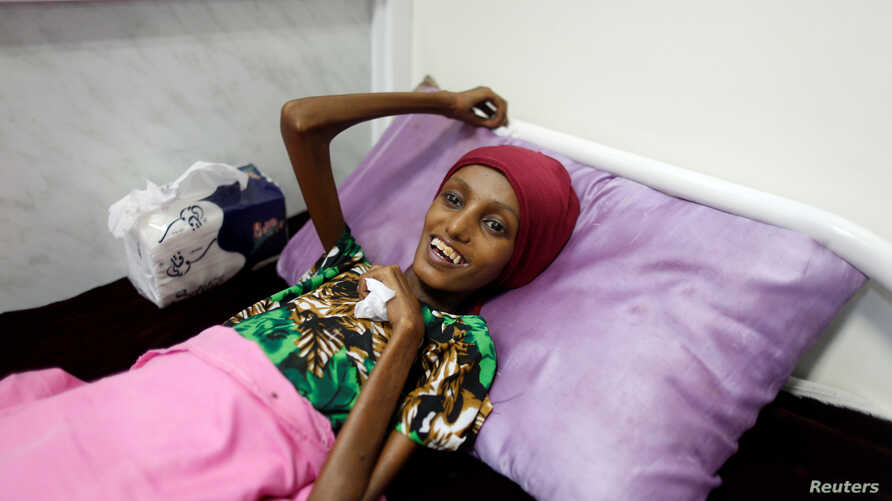 Saida Ahmad Baghili, 18, who has been affected by severe malnutrition, rests on a bed at the al-Thawra hospital in the Red Sea port city of Hodeidah, Yemen, Nov. 17, 2016.