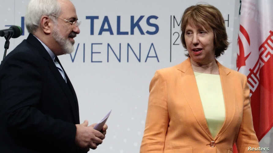 FILE - Iranian Foreign Minister Mohammad Javad Zarif (L) and European Union foreign policy chief Catherine Ashton leave a news conference in Vienna, March 19, 2014.