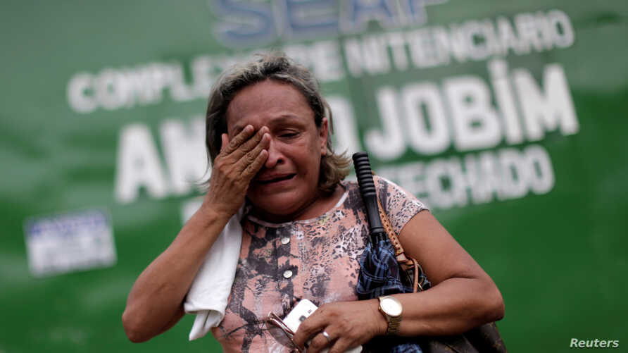 A relative of a prisoner reacts in front of the main entrance of Anisio Jobim prison in Manaus, Brazil, Jan. 3, 2017.