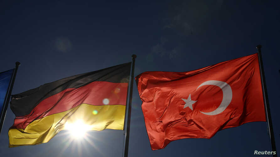 FILE - Turkish and German flags flutter before the visit of Turkish President Recep Tayyip Erdogan, at the airport in Berlin, Germany, Sept. 27, 2018.