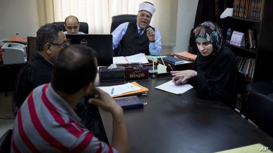 Veiled Ambition West Bank Unequal Under The Law: In this Monday, April 25, 2016 photo Palestinian divorce lawyer Reema Shamashneh, right, argues a case in a court in Ramallah, West Bank.