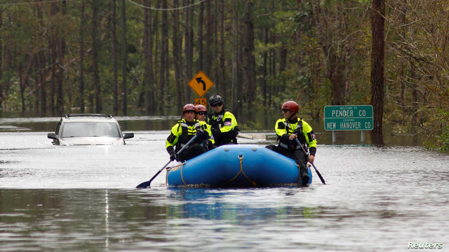 A search and rescue task force patrols a flooded region by boat over a fully submerged road in the aftermath of Hurricane Florence in Castle Hayne, North Carolina, Sept. 17, 2018.