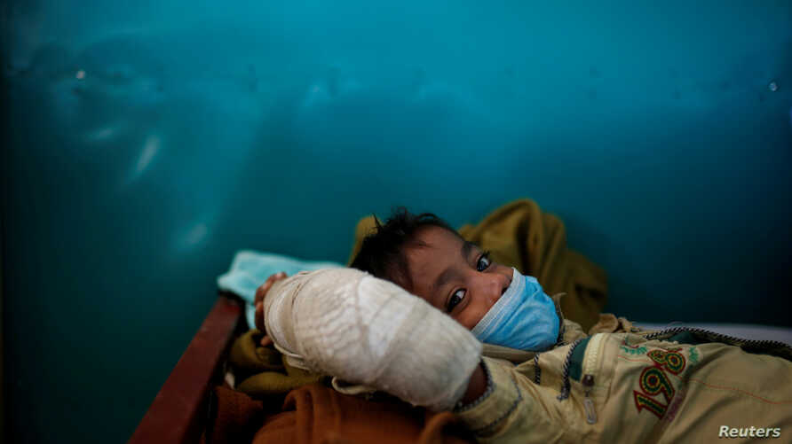 Rohingya refugee Yasin Arfat, 6, who suffers from diphtheria, lays on a bed at a Medecins Sans Frontieres (MSF) clinic near Cox's Bazar, Bangladesh.