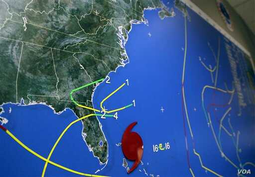 A map at the National Hurricane Center in Miami indicates Hurricane Sandy's position moving through the Bahamas off the east coast of Florida, October 26, 2012. Hurricane Sandy left at least 38 people dead as it moved through the Caribbean, following
