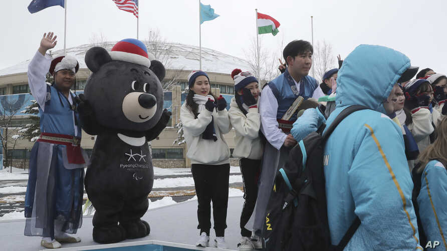 Volunteers and performers gather with Paralympic mascot Bandabi for a photo after taking part in a welcome ceremony at the Pyeongchang Olympic Village ahead of the 2018 Winter Paralympics in Pyeongchang, South Korea, March 8, 2018.