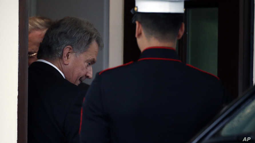 Finnish President Sauli Niinisto departs the West Wing of the White House, Sept. 27, 2018, in Washington.