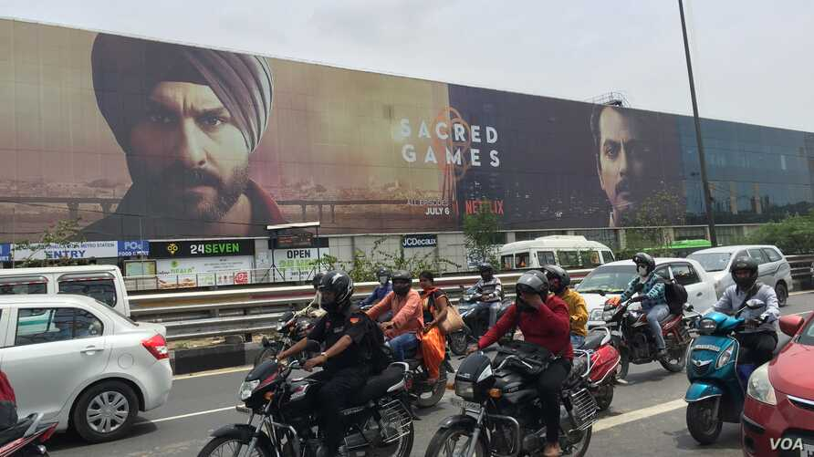 """Huge billboards at a New Delhi junction announced the arrival last month of the first original series produced by Netflix in India: """"Sacred Games,"""" a thriller about the Mumbai underworld."""