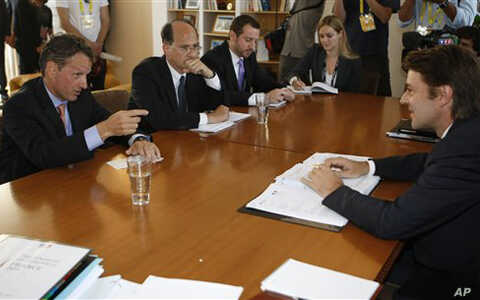 French Finance Minister Francois Baroin (r) listens to U.S Secretary of the Treasury Timothy Geithner (l) during talks in Marseilles,  Sept.9, 2011