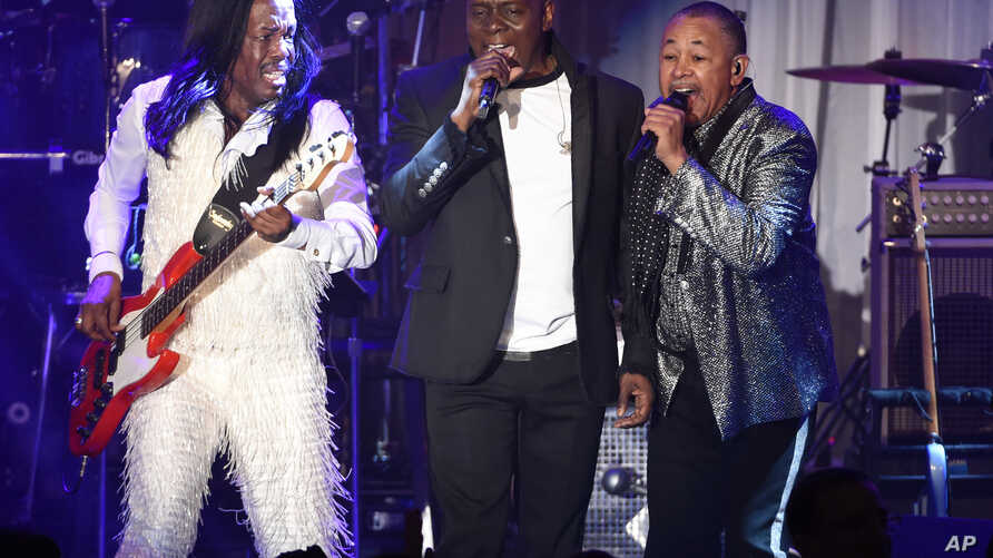 FILE - Verdine White, from left, Philip Bailey and Ralph Johnson of Earth, Wind and Fire perform at the 2016 Clive Davis Pre-Grammy Gala in Beverly Hills, California, Feb. 14, 2016.