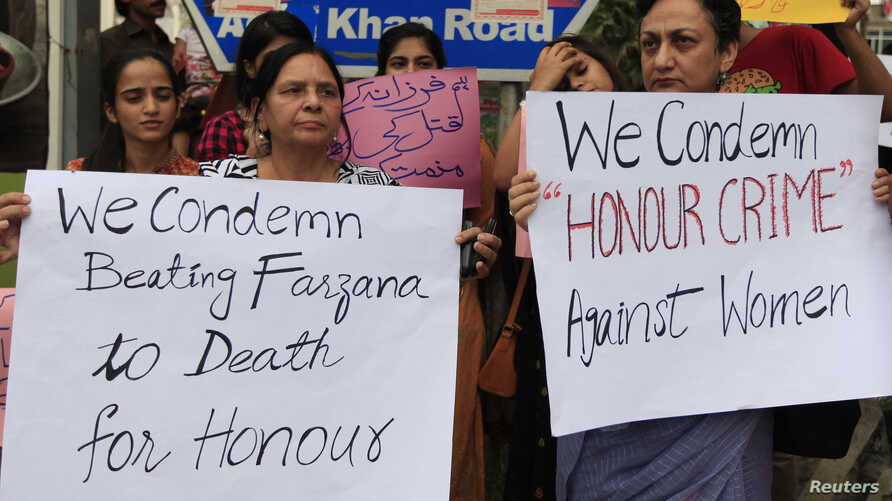 Members of civil society and the Human Rights Commission of Pakistan hold placards during a protest in Islamabad, May 29, 2014.
