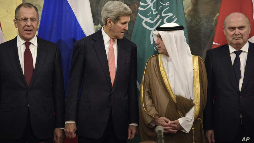 From left, Russian Foreign Minister Sergei Lavrov, Secretary of State John Kerry, Saudi Foreign Minister Adel al-Jubeir and Turkish Foreign Minister Feridun Sinirlioglu stand together before a meeting in Vienna, Austria, Oct. 29, 2015.