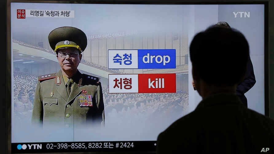 A man watches a TV screen showing a file picture of Ri Yong Gil, the former head of North Korea's military, at the Seoul Railway Station in Seoul, South Korea, May 11, 2016.