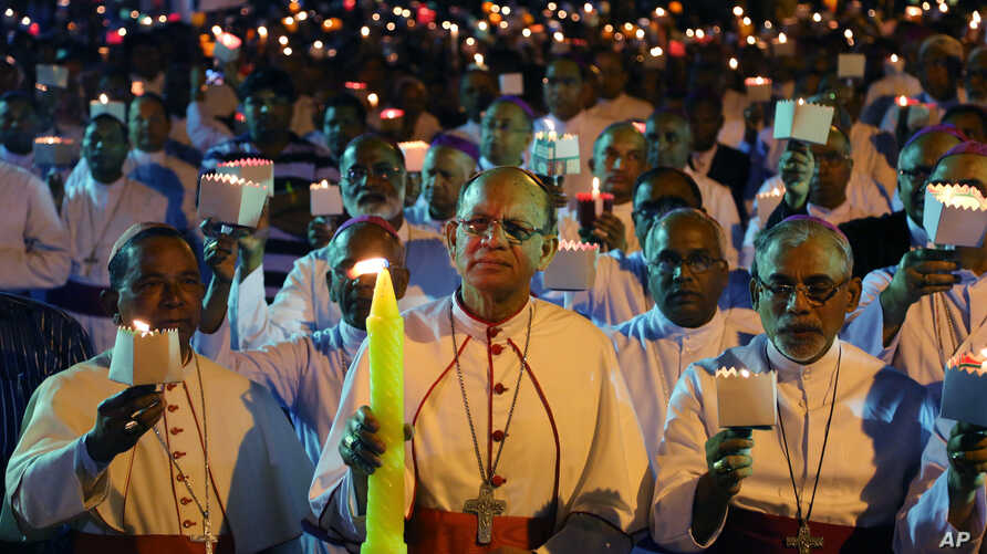 FILE - Catholic Bishops from different Indian states participate in a candle light vigil to protest against recent attacks on churches in the Indian capital, as they assemble outside St. Antony's Church after attending the 27th Plenary Assembly of th
