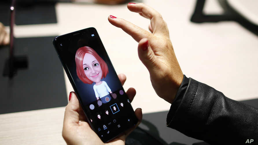 A woman holds the new Galaxy S9 during the Samsung Galaxy Unpacked 2018 event on the eve of the Mobile World Congress wireless show, in Barcelona, Spain, Feb. 25, 2018.