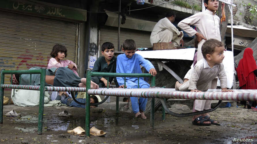 Refugees, who fled the military offensive against the Pakistani militants in North Waziristan, sit on a bed in Bannu, Khyber-Pakhtunkhwa, Pakistan, June 19, 2014.