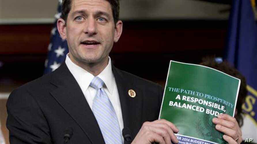 Cong. Paul Ryan holds copy of 2014 Budget Resolution March 12, 2013