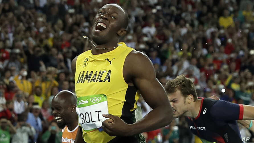 Usain Bolt from Jamaica celebrates after crossing the line to win the gold medal in the men's 200-meter final during the athletics competitions of the 2016 Summer Olympics at the Olympic stadium in Rio de Janeiro, Brazil, Thursday, Aug. 18, 2016.