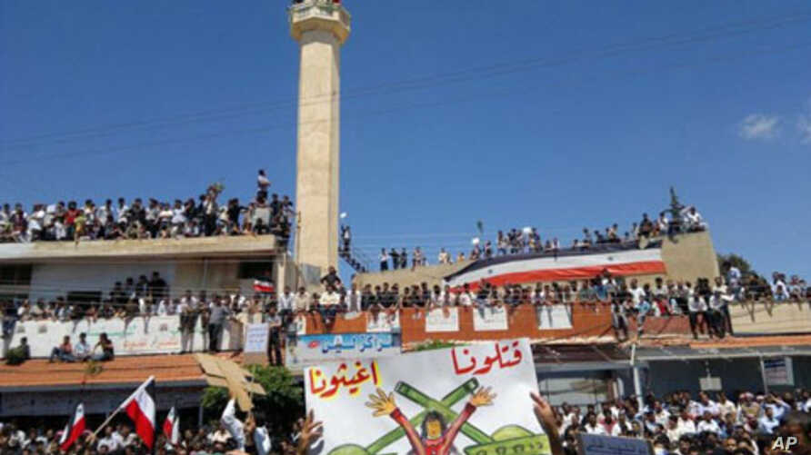 Demonstrators protesting against Syria's President Bashar al-Assad gather in Deraa, in this undated handout released November 11, 2011.