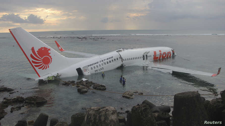 A Lion Air plane is seen in the water after it missed the runway in Denpasar, Bali in this picture provided by the Indonesian police April 13, 2013. All 108 passengers and crew miraculously survived when a Lion Air Boeing 737 missed the runway on the...