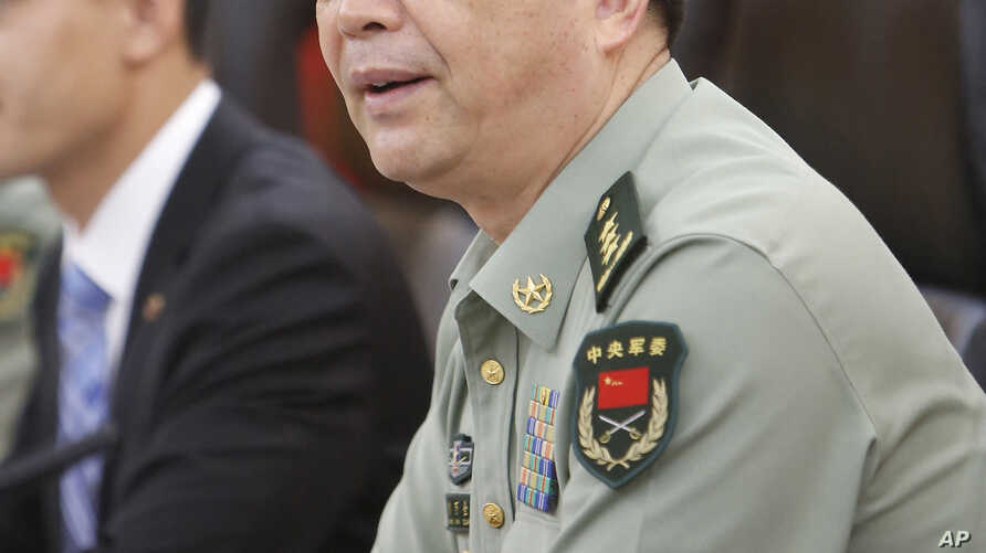 FILE - In this July 18, 2013 file photo Chinese Defense Minister Chang Wanquan speaks during a meeting at Chinese Defense Ministry headquarters in Beijing.