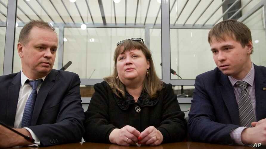 FILE - Oksana Sevastidi, with her lawyers, awaits a court hearing in the Russian Supreme court in Moscow, Russia, March 15, 2017. Sevastidi was convicted of treason for sending text messages about military movements near Georgia's breakaway republic